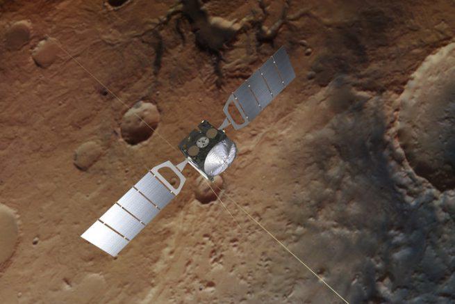 Vue d'artiste. La sonde européenne Mars Express survolant la planète rouge. Un lac d'eau liquide se trouverait à 1,5 km sous la surface.